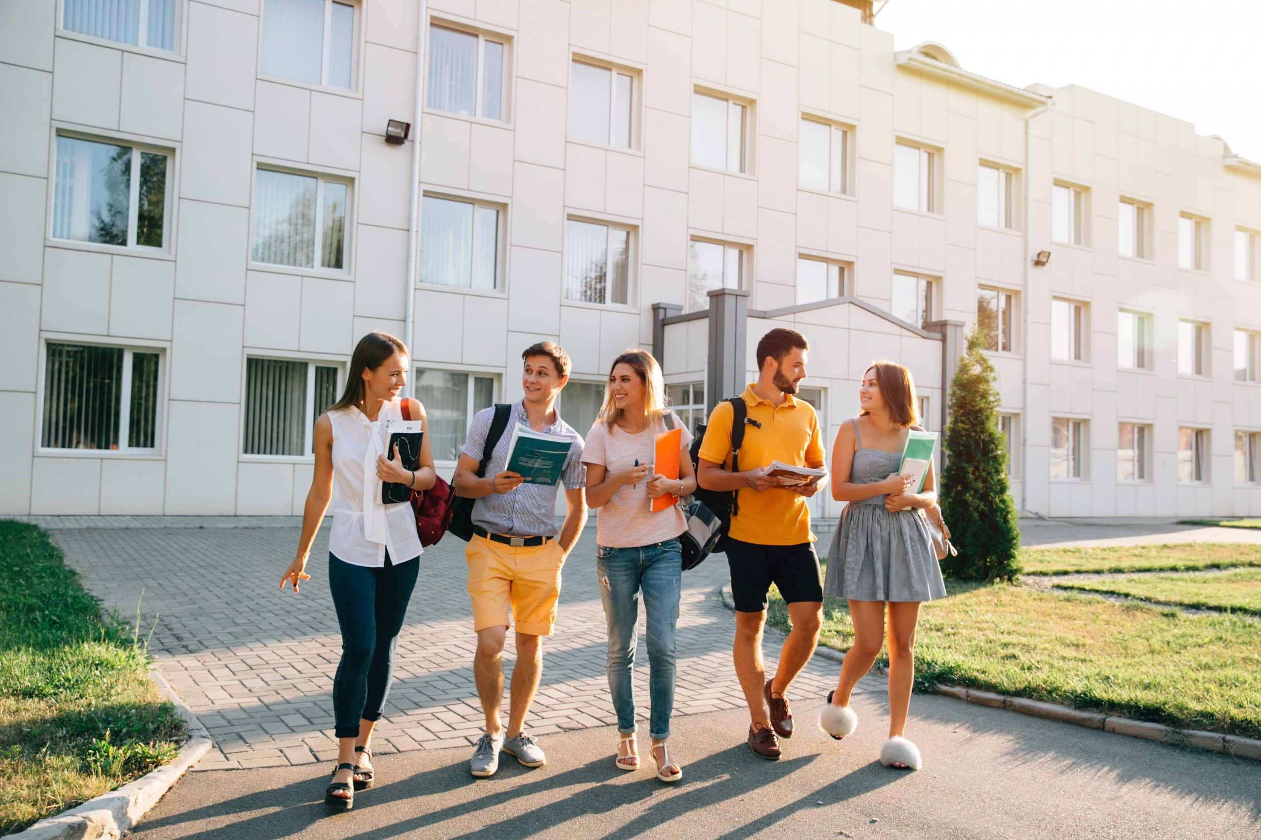 free time students bachelor s campus life rhythm five friendly students are walking